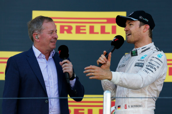 Sochi Autodrom, Sochi, Russia. Sunday 1 May 2016. Martin Brundle, TV Commentator, Sky Sports F1, interviews Nico Rosberg, Mercedes AMG, 1st Position, on the podium. World Copyright: Sam Bloxham/LAT Photographic ref: Digital Image _R6T6757