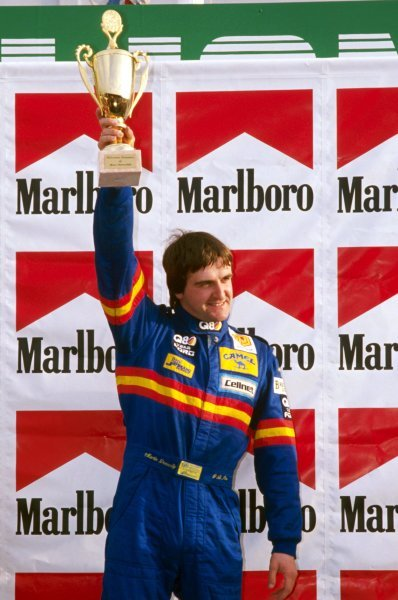 Martin Donnelly (GBR) Eddie Jordan Racing celebrates his second win of the season on the podium. International Formula 3000 Championship, Rd 11, Dijon-Prenois, France, 23 October 1988.