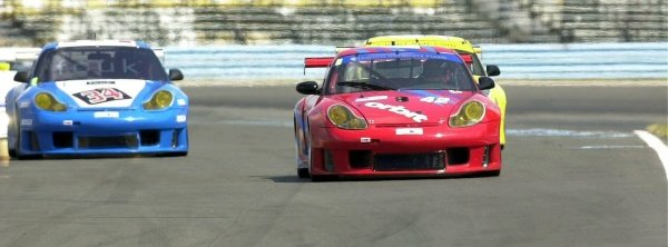 2001 Watkins Glen 2hr. Grand Am,Watkins Glen, NY, USAAugust 2001Tommy Byrne in the Porsche GT3R stays off Rick Dolorio in similiar caras well as yet another GT Porsche frombehind all going into turn 11.C: 2001,  Denis L. Tanney, World