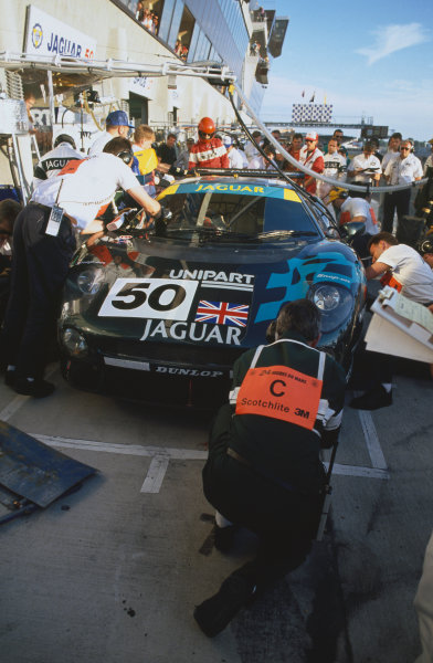 1993 Le Mans 24 Hours. Le Mans, France. 19th - 20th June 1993. John Nielsen/David Brabham/David Coulthard (Jaguar XJ220C), disqualified from a class win, pit stop action. World Copyright: LAT Photographic. Ref:  93LM32