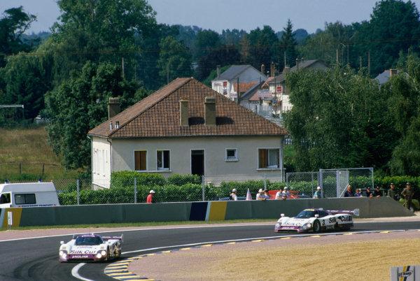 1990 Le Mans 24 Hours Le Mans, France. 16th - 17th June 1990. Martin Brundle/Alain Ferte/David Leslie (Jaguar XJR12), retired leads Martin Brundle/John Nielsen/Price Cobb/Eliseo Salazar (Jaguar XJR12), 1st position, action. World Copyright: LAT Photographic. Ref: 90LM45.