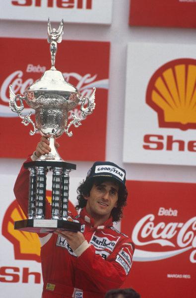 Jacarepagua, Rio de Janeiro, Brazil.1-3 April 1988.Alain Prost (McLaren MP4/4 Honda), 1st position, podium,  portrait. World Copyright: LAT Photographic. Ref: 88BRA56