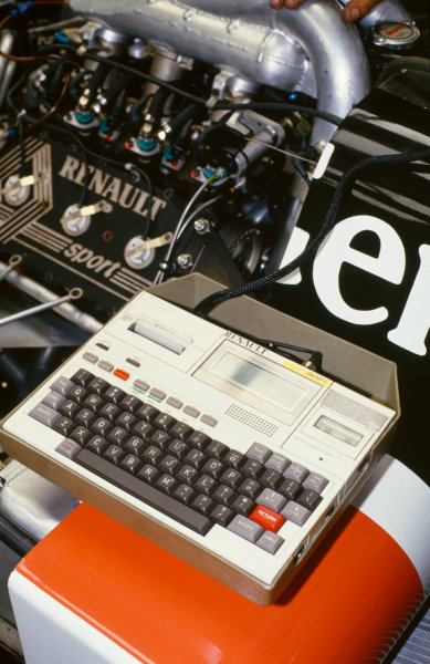1986 German Grand Prix Hockenheim, Germany 25 - 27 July 1986 A computer plugged into the Renault EF15 V6 Turbo engine in the back of a Tyrrell 015 car in the garage. World Copyright: LAT Photographic Ref: 35mm Transparency 86GER38