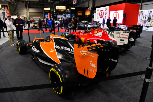 Autosport International Exhibition. National Exhibition Centre, Birmingham, UK. Thursday 11th January 2017. A line-up of cars, including a McLaren and Ferrari, on the F1 Racing Stand.World Copyright: Mark Sutton/Sutton Images/LAT Images Ref: DSC_7089