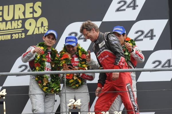 Circuit de La Sarthe, Le Mans, France. 21st-23rd June 2013. Marc Gene/Lucas di Grassi/Oliver Jarvis, Audi Sport Team Joest, No 3 Audi e-tron quattro celebrate win. World Copyright: Jeff Bloxham/LAT Photographic ref: Digital Image DSC_9645