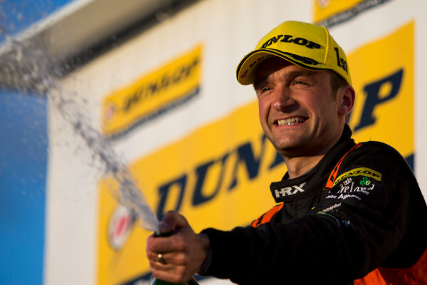 2015 British Touring Car Championship, Silverstone, Northamptonshire, England. 26th - 27th September 2015. Colin Turkington (GBR) Team BMR Volkswagen Passat CC, 1st position, on the podium. World Copyright: Zak Mauger/LAT Photographic. ref: Digital Image _L0U4880