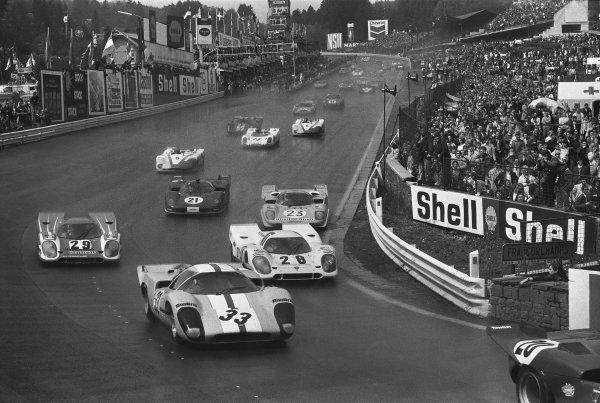 1970 Spa Francorchamps 1000 kms. Spa Francorchamps, Belgium. 17th May 1970. Rd 6. Jo Bonnier/Reine Wisell (#33 Lola T70 Mk3B), 10th position, leads Vic Elford/Kurt Ahrens, Jr. (#28 Porsche 917K), 3rd position, Richard Attwood/Hans Herrmann (#29 Porsche 917K), 6th position, Derek Bell/Hughes de Fierlant (#23 Ferrari 512 S), 8th position and Peter Schetty/Arturo Merzario (#21 Ferrari 512 S), 7th position, at the start, action.  World Copyright: LAT Photographic. Ref: L70 - 450 - 3.