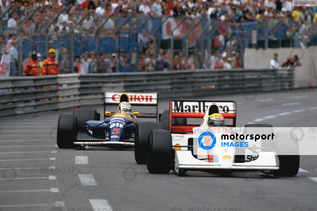 1992 Monaco Grand Prix. Monte Carlo, Monaco.  28th - 31st May 1992. Ayrton Senna (McLaren MP4/7A Honda) 1st position with Nigel Mansell (Williams FW14B Renault) 2nd position close behind, trying to pass in the last few laps of the race, action.  World Copyright: LAT Photographic.  Ref:  92 MON 22.