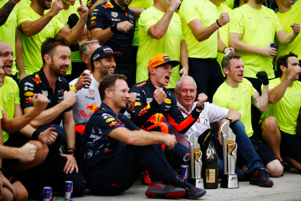 Sepang International Circuit, Sepang, Malaysia. Sunday 01 October 2017. Max Verstappen, Red Bull Racing, celebrates victory with Daniel Ricciardo, Red Bull Racing, Christian Horner, Team Principal, Red Bull Racing, Helmut Markko, Consultant, Red Bull Racing and other colleagues. World Copyright: Zak Mauger/LAT Images  ref: Digital Image _X0W9267