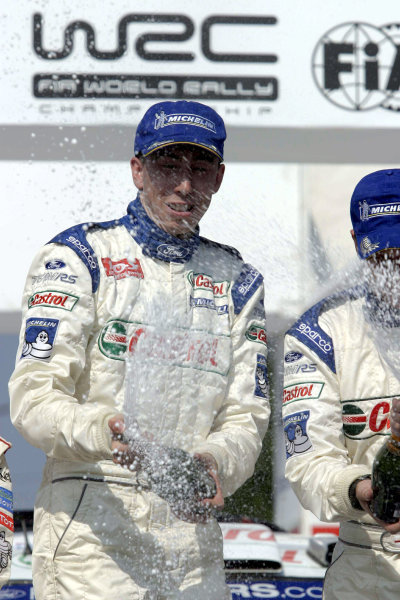 Markko Martin & co-driver Michael Park celebrate victory, Ford Focus RS WRC03, Acropolis Rally 2003.