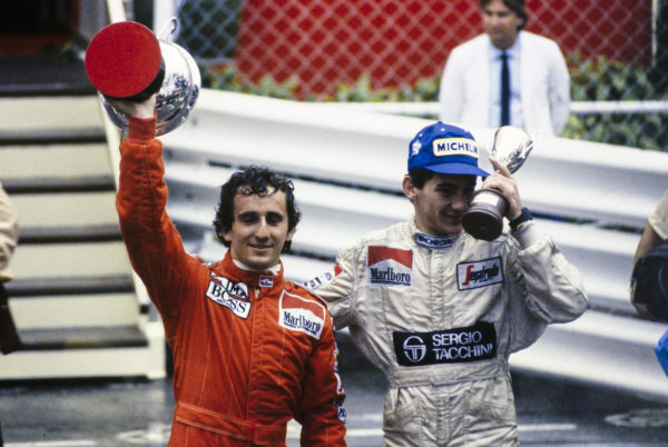 Alain Prost and Ayrton Senna with their trophies.