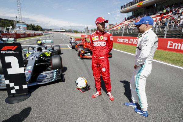 Sebastian Vettel, Ferrari and Pole Sitter Valtteri Bottas, Mercedes AMG F1 talk in Parc Ferme
