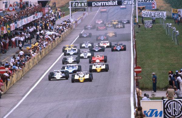 1980 Austrian Grand Prix.Osterreichring, Zeltweg, Austria.15-17 August 1980.Rene Arnoux (Renault RE20) leads Alan Jones (Williams FW07B Ford), Didier Pironi (Ligier JS11/15 Ford) and Jean-Pierre Jabouille (Renault RE20) at the start.Ref-80 AUT 03.World Copyright - LAT Photographic