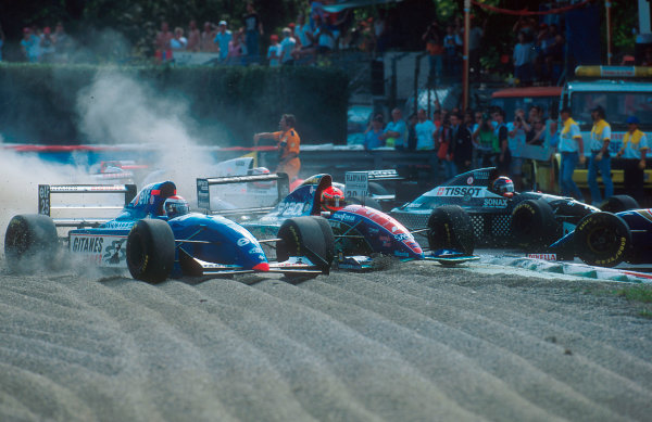 1994 Italian Grand Prix.Monza, Italy.9-11 September 1994.Eddie Irvine (Jordan 194 Hart) goes through the gravel at the Rettifilo Chicane at the start after hitting Herbert into a spin. Eric Bernard (Ligier JS39 B Renault) in the gravel and everybody else take avoiding action in the melee.Ref-94 ITA 06.World Copyright - LAT Photographic