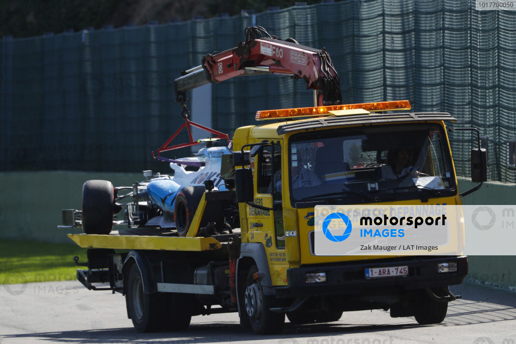 The Robert Kubica Williams FW42 is returned to the pit lane on the back of a truck