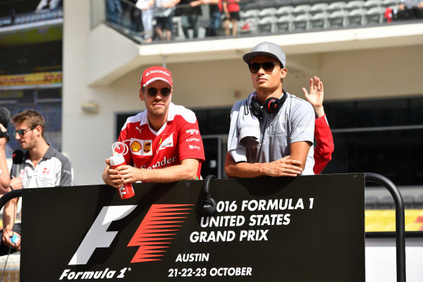 Sebastian Vettel (GER) Ferrari and Pascal Wehrlein (GER) Manor Racing on the drivers parade at Formula One World Championship, Rd18, United States Grand Prix, Race, Circuit of the Americas, Austin, Texas, USA, Sunday 23 October 2016.
