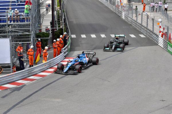 Fernando Alonso, Alpine A521, leads Valtteri Bottas, Mercedes W12
