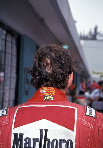 Ayrton Senna with cut to his head.