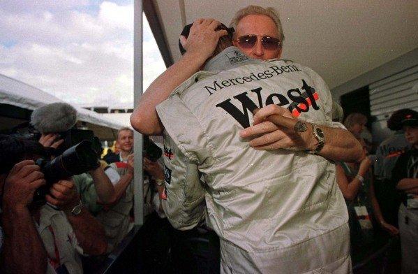 1997 European Grand Prix.Jerez, Spain.24-26 October 1997.Mika Hakkinen (McLaren Mercedes-Benz) and Dr Jurgen Hubbert of Daimler-Benz celebrate his maiden Grand Prix victory.World Copyright - LAT Photographic