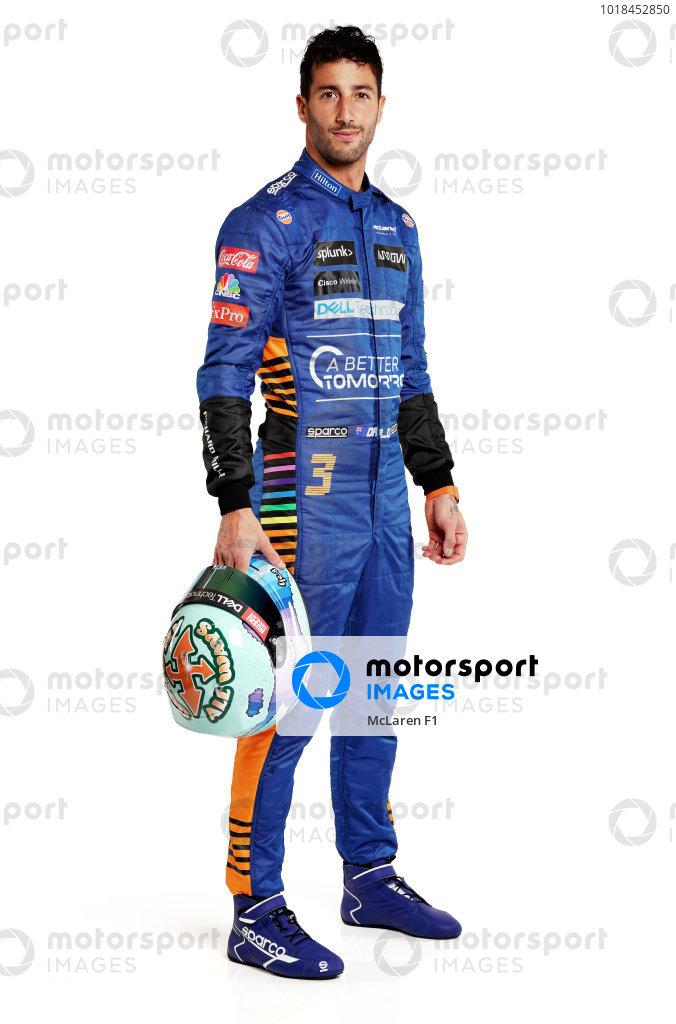 Daniel Ricciardo portrait - side on with helmet