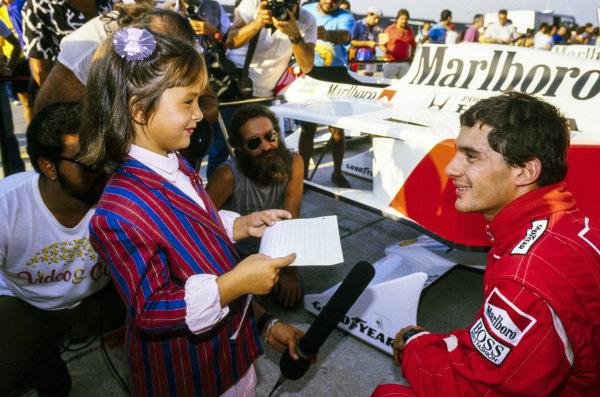 Ayrton Senna meets a young fan.