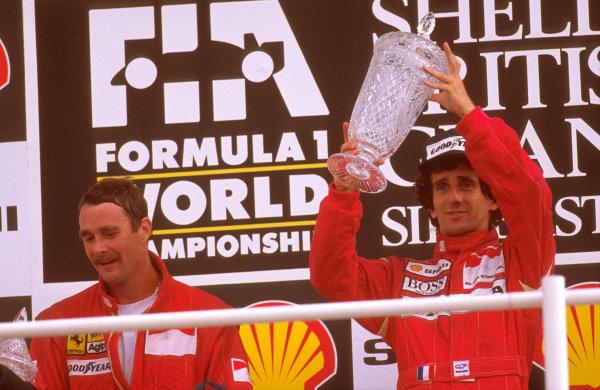 Silverstone, England.14-16 July 1989.Alain Prost (McLaren Honda) 1st position celebrates on the podium, with Nigel Mansell (Ferrari) 2nd position.Ref-89 GB 06.World Copyright - LAT Photographic