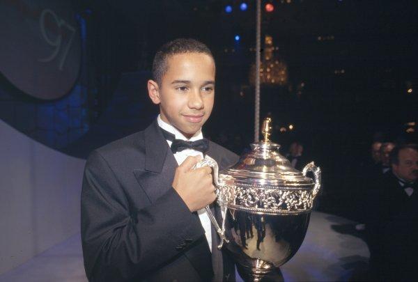 1997 Autosport Awards. Grosvenor House Hotel, Park Lane, London, Great Britain. 7 December 1997. Lewis Hamilton with his karting trophy, portrait. World Copyright: Bloxham/LAT Photographic Ref: 35mm transparency