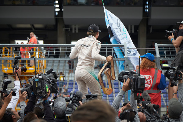 Red Bull Ring, Spielberg, Austria. Sunday 21 June 2015. Nico Rosberg, Mercedes AMG, 1st Position, celebrates with fans. World Copyright: Steve Etherington/LAT Photographic. ref: Digital Image SNE14924