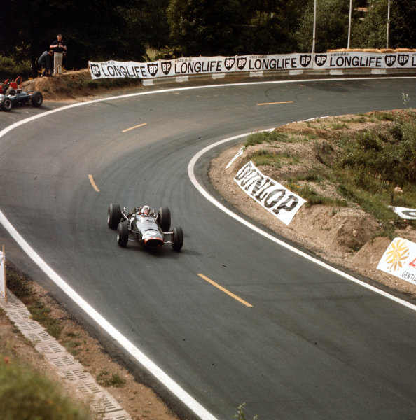 Charade, Clermont-Ferrand, France.25-27 June 1965.Jackie Stewart (BRM P261) passes the retired Cooper T77 Climax of Jochen Rindt. Stewart finished in 2nd position.Ref-3/1767.World Copyright - LAT Photographic