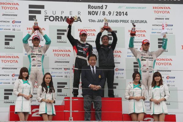 2014 Super Formula Series. Suzuka, Japan. 9th - 10th November 2014. Rd 7. Race 1 - Winner Joao Paulo de Oliveira ( #19 Lenovo TEAM IMPUL SF14 ) 2nd position Kazuki Nakajima ( #37 TEAM TOM'S SF14 ) 3rd position Andre Lotterer ( #36 PETRONAS TOM'S SF14 ) podium, portrait World Copyright: Yasushi Ishihara / LAT Photographic. Ref:  2014_SF_Rd7_007.JPG