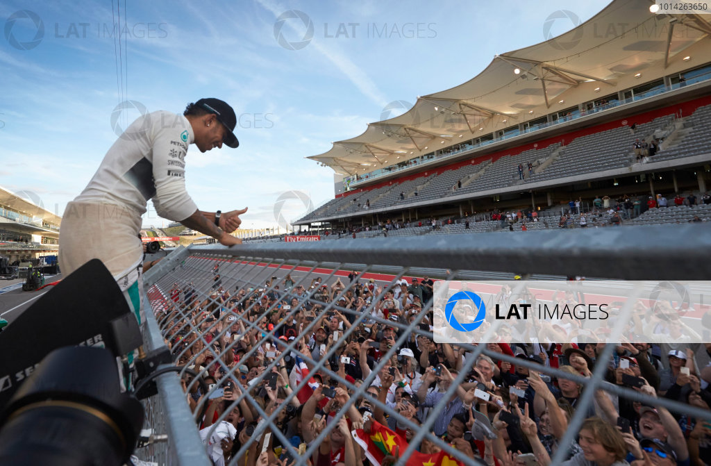 Circuit of the Americas, Austin, Texas, United States of America. Sunday 2 November 2014. Lewis Hamilton, Mercedes AMG celebrates with the fans after winning the race. World Copyright: Steve Etherington/LAT Photographic. ref: Digital Image SNE10583