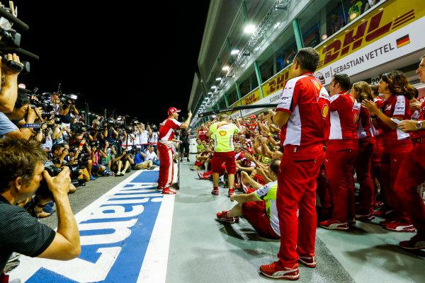 Marina Bay Circuit, Singapore. Sunday 20 September 2015. Sebastian Vettel, Ferrari, and the Ferrari team celebrate victory. World Copyright: Alastair Staley/LAT Photographic. ref: Digital Image _R6T7512