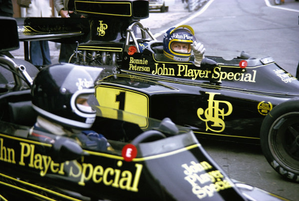 Jacky Ickx and team mate Ronnie Peterson wait to go out on track in their Lotus 72E Fords.