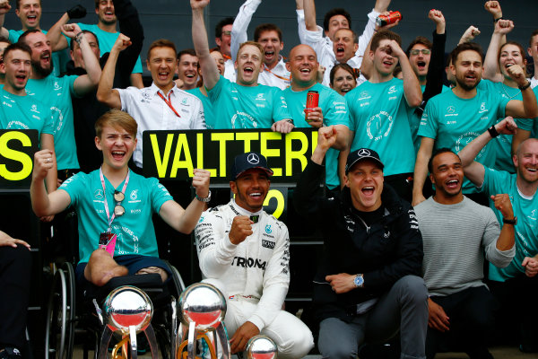 Silverstone, Northamptonshire, UK.  Sunday 16 July 2017. Lewis Hamilton, Mercedes AMG, 1st Position, and Valtteri Bottas, Mercedes AMG, 2nd Position, celebrate with Billy Monger and their team. World Copyright: Andrew Hone/LAT Images  ref: Digital Image _ONY8173