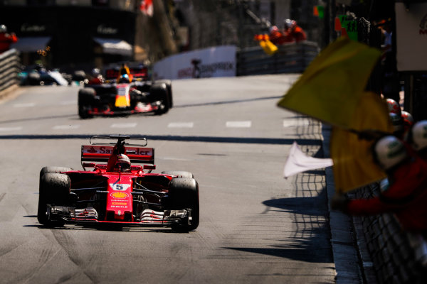 Monte Carlo, Monaco. Sunday 28 May 2017. Winner Sebastian Vettel, Ferrari SF70H, celebrates as the marshals wave flags. World Copyright: Zak Mauger/LAT Images ref: Digital Image _54I9744