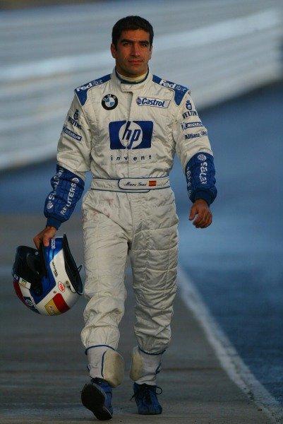 Marc Gene (ESP) Williams Test Driver walks back to the pits.Formula One Testing , 12 - 15 December 2002Jerez, Spain.DIGITAL IMAGE