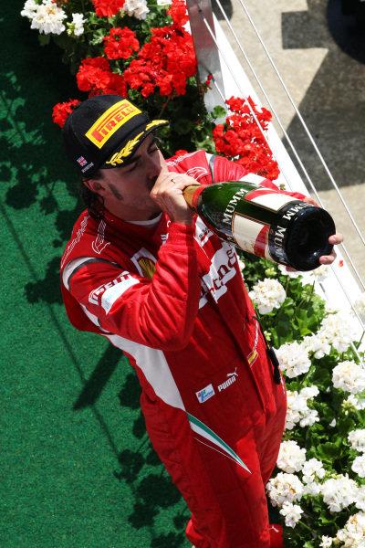 Fernando Alonso (ESP) Ferrari on the podium.  Formula One World Championship, Rd 9, British Grand Prix, Race, Silverstone, England, Sunday 10 July 2011.  BEST IMAGE