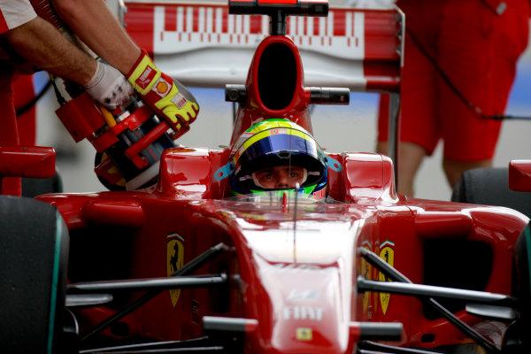 Sepang, Kuala Lumpur, Malaysia 3rd April 2009 Felipe Massa, Ferrari F60, refuels in the pit lane. Action. Pit Stops. Portrait. Helmets.  World Copyright: Glenn Dunbar/LAT Photographic ref: Digital Image _O9T4889