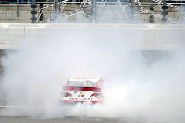 4-6 October, 2013, Kansas City, Kansas USA Kevin Harvick celebrates his win with a burnout ©2013, Nigel Kinrade LAT Photo USA