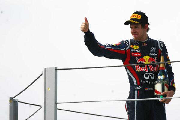 Interlagos, Sao Paulo, Brazil.27th November 2011.Sebastian Vettel, Red Bull Racing RB7 Renault, 2nd position. Portrait. Podium. World Copyright:Andy Hone/LAT Photographicref: Digital Image  CSP20647
