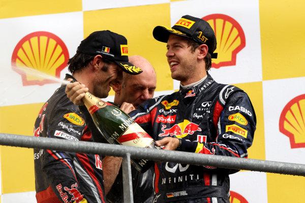 Spa-Francorchamps, Spa, Belgium28th August 2011.Sebastian Vettel, Red Bull Racing RB7 Renault, 1st position, sprays Champagne. Portrait. Podium. World Copyright: Andy Hone/LAT Photographicref: Digital Image CI0C2546