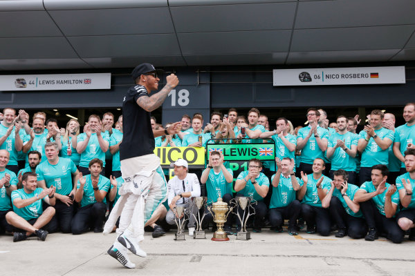 Silverstone Circuit, Northamptonshire, England. Sunday 5 July 2015. Lewis Hamilton, Mercedes AMG, 1st Position, celebrates with his team. World Copyright: Alastair Staley/LAT Photographic ref: Digital Image _79P3961