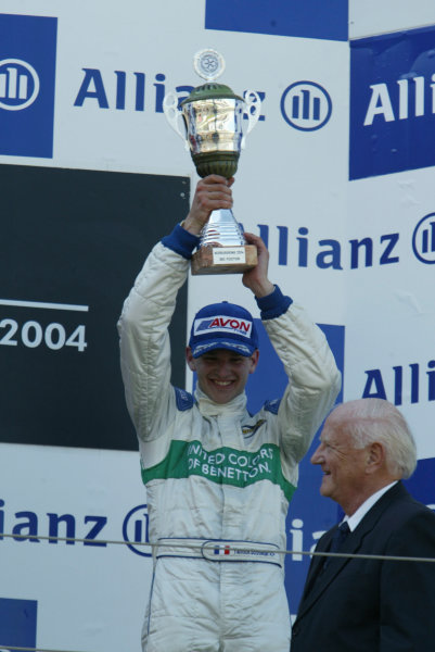 2004 Formula 3000 Championship (F3000) Nurburgring, Germany.29th May 2004. Yannick Schroeder (Durango Formula) celebrates his thrid place from the podium.World Copyright: LAT Photographic ref: Digital Image Only