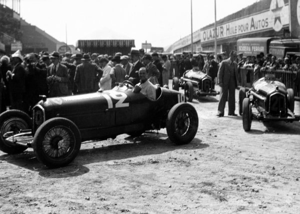 "1934 French Grand Prix Montlhery, France. 1 July 1934 The Alfa Romeo Tipo-B ""P3"" cars of Louis Chiron (in car), Carlo Felice Trossi and Achille Varzi arrive for scrutineering, atmosphere World Copyright: Robert Fellowes/LAT PhotographicRef: 34FRA04"