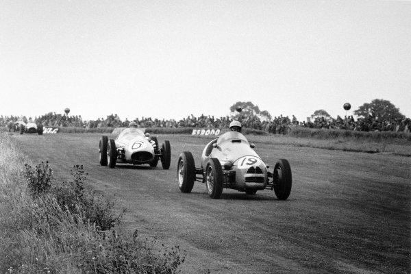 "1954 British Grand Prix Silverstone, Great Britain. 17 July 1954 Andre Pilette, Gordini 16, 9th position, leads ""B Bira"", Maserati 250F, retired, action World Copyright: LAT PhotographicRef: Autosport b&W print"
