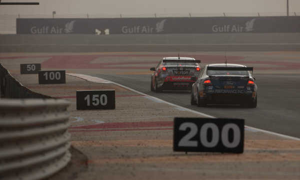 Round 2 - Gulf Air Desert 400Bahrain International Circuit, Sakhir, Bahrain.24th - 27th Febraury 2010.Jamie Whincup of Triple Eight Racing leads Mark Winterbottom of Ford Performance Racing.World Copyright: Mark Horsburgh/LAT Photographicref: Digital Image race 2-EV02-11219