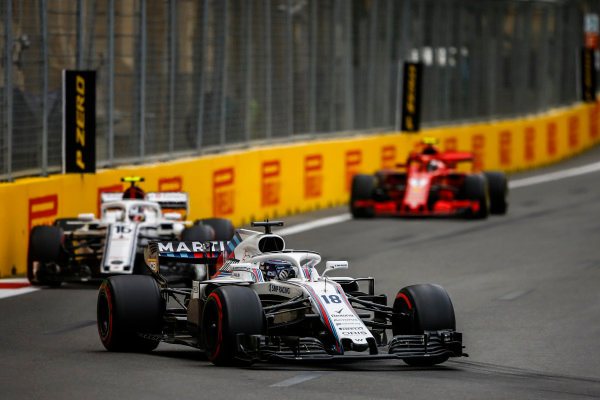 Lance Stroll, Williams FW41 Mercedes, leads Charles Leclerc, Sauber C37 Ferrari, and Kimi Raikkonen, Ferrari SF71H.