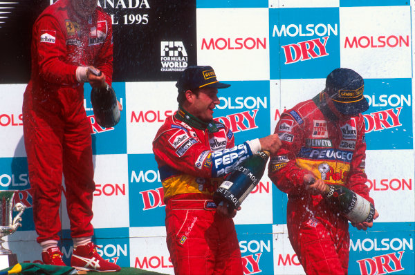 Montreal, Quebec, Canada.9-11 June 1995.Rubens Barrichello, 2nd position and Eddie Irvine, 3rd position (both Jordan Pugeot) celebrate on the podium.Ref-95 CAN 05.World Copyright - LAT Photographic