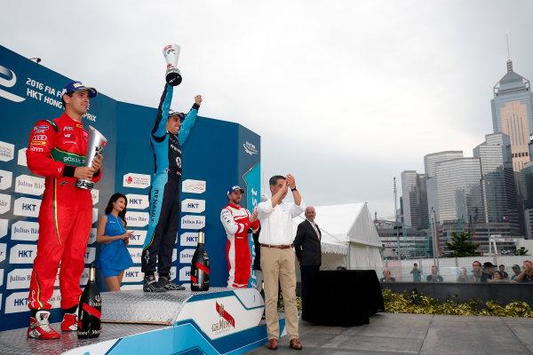 FIA Formula E Hong Kong e-Prix. Podium. Sebastien Buemi (SUI), Renault e.Dams, Spark-Renault, Renault Z.E 16, Lucas Di Grassi (BRA), ABT Schaeffler Audi Sport, Spark-Abt Sportsline, ABT Schaeffler FE02, Nick Heidfeld (GER), Mahindra Racing, Spark-Mahindra, Mahindra M3ELECTRO. Hong Kong Harbour, Hong Kong, Asia. Sunday 9 October 2016. Photo: Adam Warner / FE / LAT ref: Digital Image _L5R8408