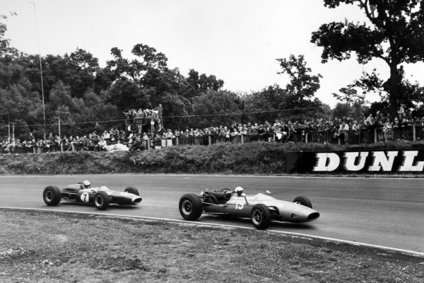 1966 British Grand Prix.Brands Hatch, Great Britain. 16 July 1966.Guy Ligier, Cooper T81-Maserati, 10th position, leads Chris Irwin, Brabham BT11-Climax, 7th position, action.World Copyright: LAT Photographic